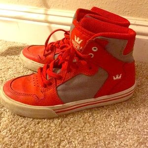 Gently used Boys Supra high tops size 1